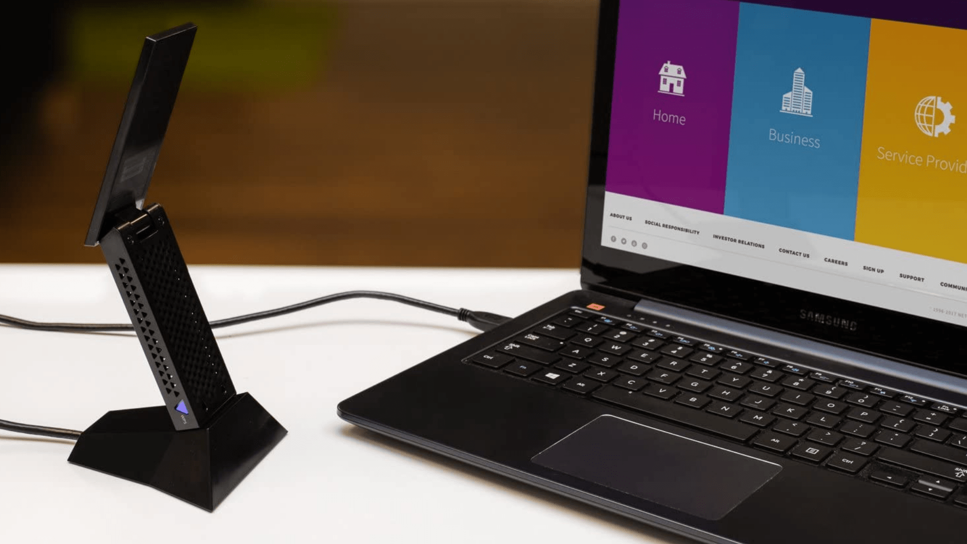 The Netgear Nighthawk A7000 USB WiFi Adapter is connected to a Samsung laptop